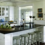 white kitchen island with black granite top