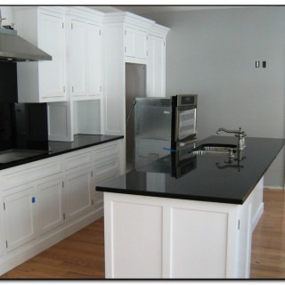 white kitchen cabinets granite countertops