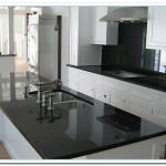 black granite countertops with white cabinets