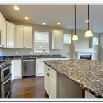 dark countertops with white cabinets