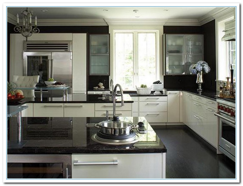 White cabinets dark countertops details home and cabinet for Best countertops for white kitchen cabinets
