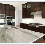 white countertops with dark cabinets
