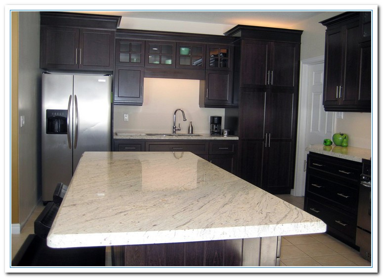 White cabinets dark countertops details home and cabinet for Dark cabinets light countertops