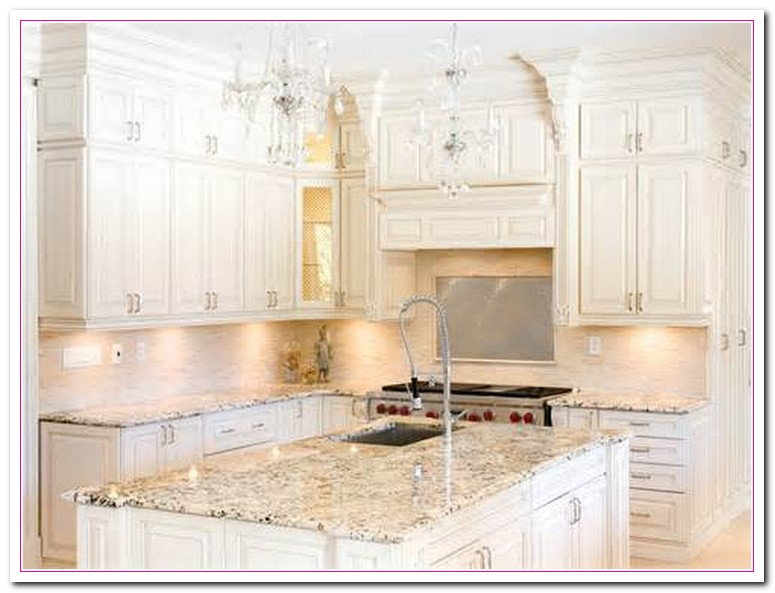 Working on white granite countertop for luxury kitchen for Pictures of white kitchen cabinets with granite countertops