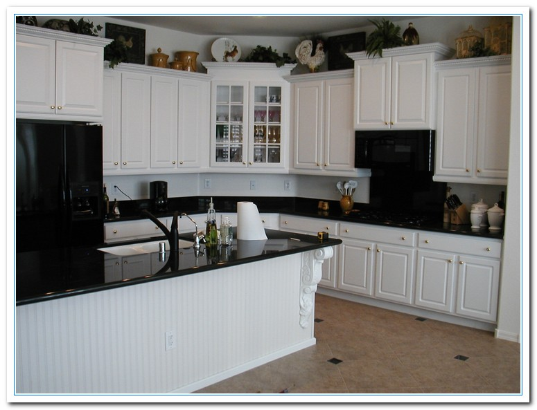 White cabinets with granite countertops home and cabinet for Black kitchen cabinets with white marble countertops