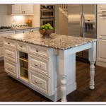 white kitchen island with granite top