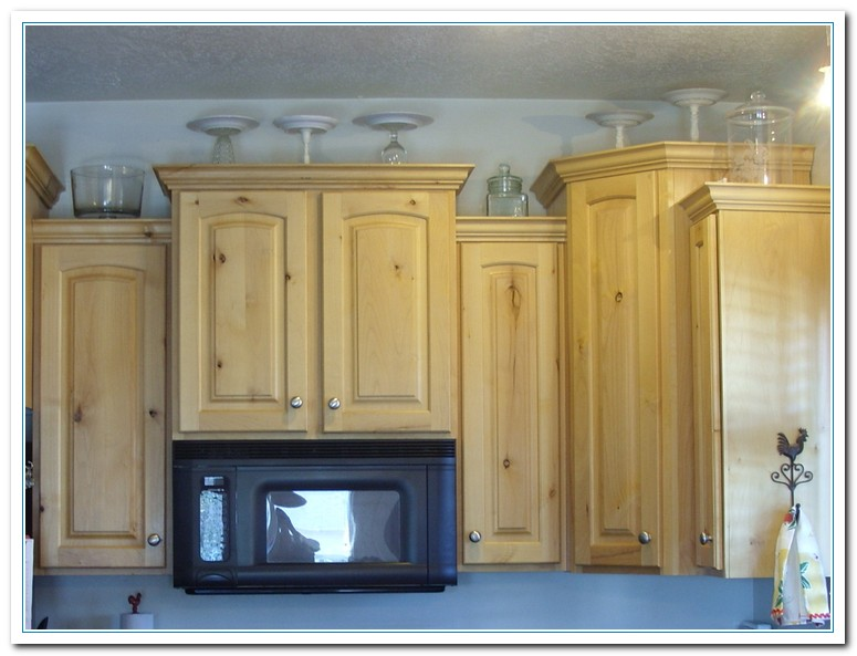 Weird decorating above kitchen cabinets weird decorating for Above cupboard decoration ideas