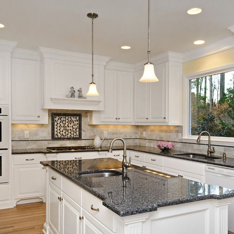 The advantages of choosing blue pearl granite countertops for White kitchen cabinets with blue pearl granite
