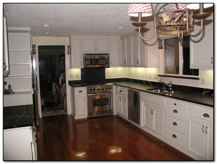 white cabinet kitchen kitchen with black countertops for design home 28509
