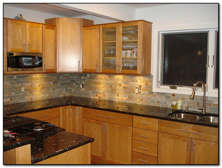 Oak cabinets with granite countertops home and cabinet for Granite colors for black cabinets