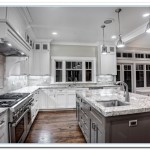 granite countertops with white kitchen cabinets
