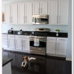 pictures of kitchens with white cabinets and black countertops