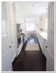white kitchen cabinets dark wood floors