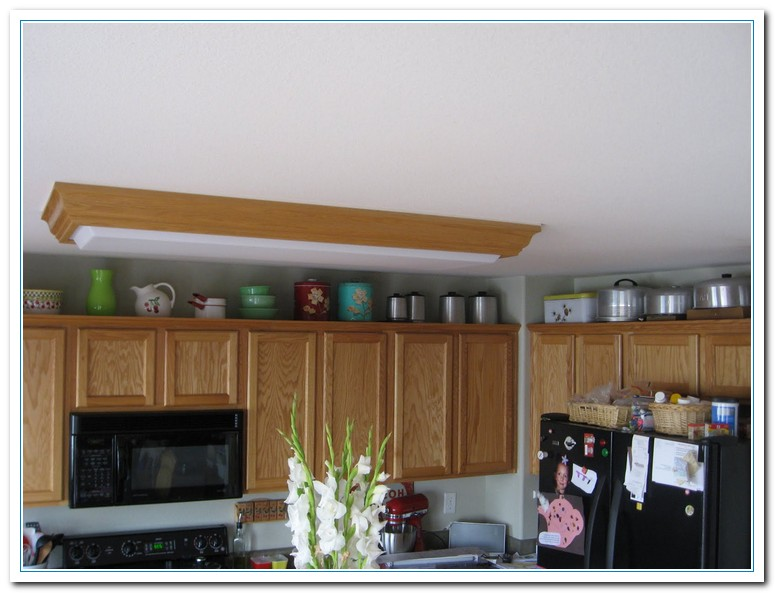 decorate top of kitchen cabinets